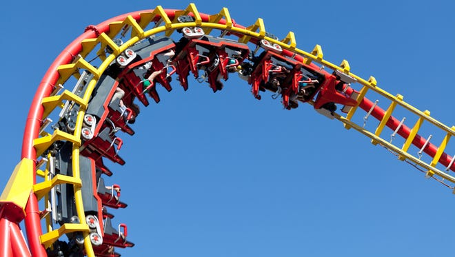 rollercoaster against blue sky, entertainment in amusement park