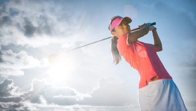 A women swinging at the golf ball on a beautiful course. http://blog.michaelsvoboda.com/GolfBanner.jpg