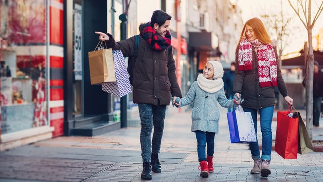 Family with one kid shopping together