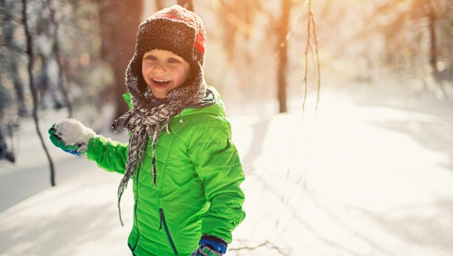 Boy holding a snow ball