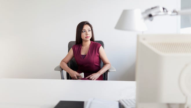 Young woman sitting in private office space