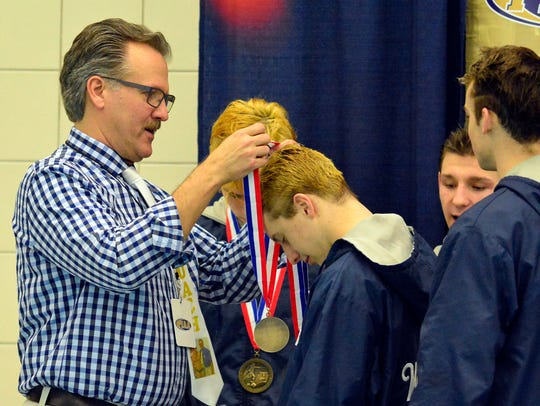 Dallastown head coach Rich Howley (left) coached six
