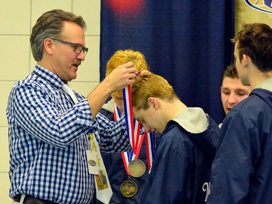 Dallastown head coach Rich Howley (left) coached six PIAA state champions in his 30 years as coach of the Wildcats' swimming program. John A. Pavoncello photo