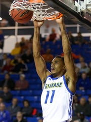 Delaware's Chyree Walker slams in the first half against Wesley at the Bob Carpenter Center Friday.