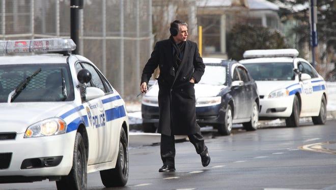 A file photo of Gary Galetta, a homicide investigator with RPD, at the crime scene on Chili Avenue.