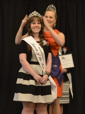 Heather Duquaine, front, of De Pere has a tiara placed on her head by 2014 winner Deanna Schlies after being named the 2015 Brown County Fairest of the Fair at a Sunday gala at Tundra Lodge Resort & Conference Center in Green Bay.