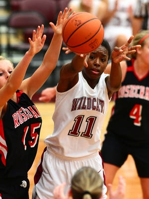 In this 2013 file photo, Newark junior Kym Royster passes the ball under pressure from the Bishop Rosecrans defense during a Newark Lions Club Foundation Game.