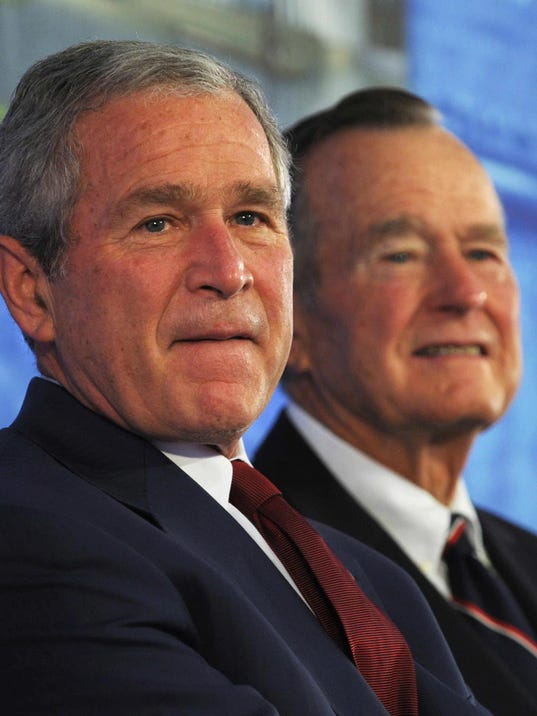 US President George W. Bush (L) and his