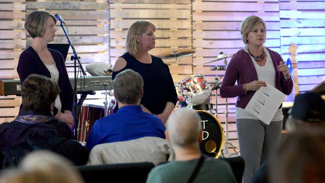 Shelly Romine, right, speaks during a presentation she's giving with Holly Griffith and Tonya Mundy at Together Ministries Saturday night, April 28, 2018, in Berne Township. The trio of Fairfield Medical Center employees have been traveling to community groups, businesses and churches this year to talk about the importance of cancer screenings