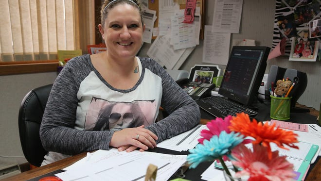Jessica Wilson, a youth advocate for the Personal Development Center in Marshfield, is pictured at her desk at the center in May. She provides presentations and counseling for students on domestic abuse prevention, sexual assault, and other topics.