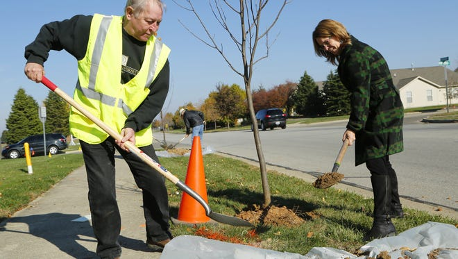Don Wood and Bev Shaw help plant a tree as West Lafayette Tree Fund celebrates the sixth annual Founder's Day with a tree planting ceremony Nov. 10, 2015. West Lafayette received a DNR grant of more than $18,000 for tree replacement and tree inventory.
