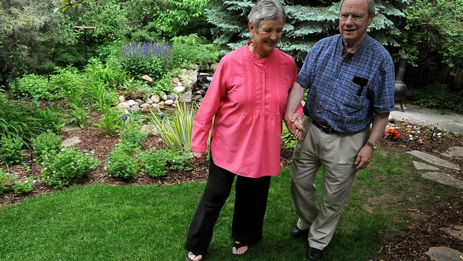 Tom Sutherland, 79, and wife, Jean, walk through the backyard of their Fort Collins home Tuesday June 8, 2010. Sutherland, a former CSU professor, was captured in Beirut 25 years ago. He was held hostage for six and half years before being released in 1991.