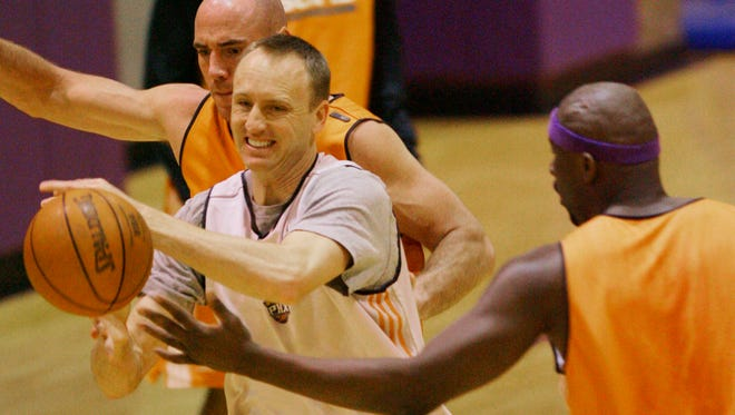 Phoenix Suns reserve players Pat Burke, left, of Ireland, Eric Piatkowski, center, and Jumaine Jones during basketball practice at U.S. Airways Center Monday, April 30, 2007 in Phoenix.  The Suns host the Los Angeles Lakers in Game 5 of their first round Western Conference playoff series, which they are leading 3-1.  (AP Photo/Ross D. Franklin)