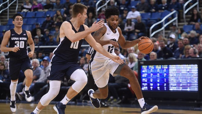 Elijah Foster dribbles the ball up the court in Nevada's game against Utah State on Saturday.