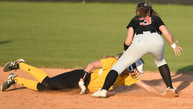 South Side's Chloe Matthews tags Scotts Hill's Melanie Alexander out before she can make it back to second base after attempting to steal third during their game, Thursday, April 12. South Side defeated Scotts Hill, 4-0.