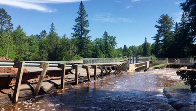 Torrential downpours in northern Wisonsin have caused trouble in northern WI counties. This photo provided by the Wisconsin Department of Transportation shows