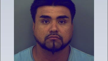 Smoking truck leads to fugitive's arrest