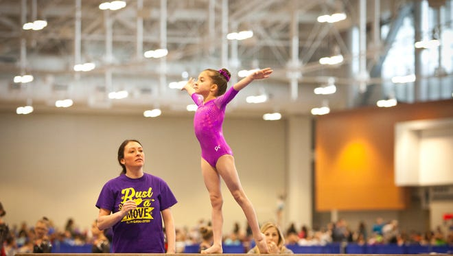 Whysper Stephenson does a routine on the beam.