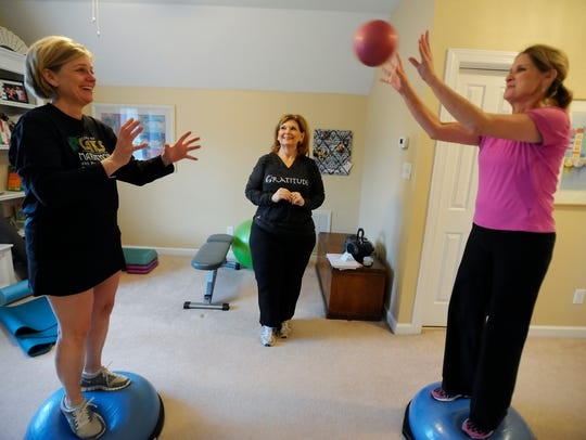 In this file photo, women exercise on Bosu balls.