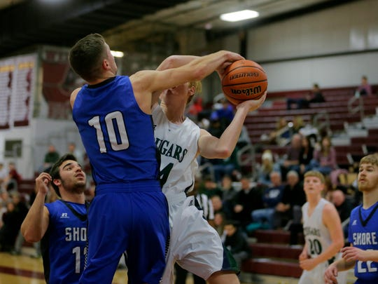 Shore Regional's Kyle Koob fouls Colts Neck's Sean Tice as he goes up for a shot during the 2017 Albert E. Martin Buc Basketball Classic at Red Bank Regional High School in Little Silver, NJ Wednesday, December 27, 2017.