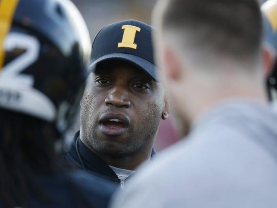 Iowa wide receivers coach Kelton Copeland, instructing