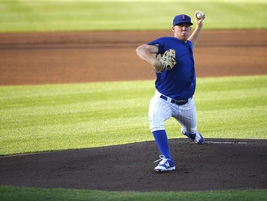 Pitcher Rob Zastryzny winds up as the Iowa Cubs play