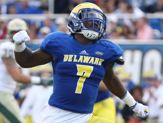 Ray Jones celebrates after a defensive stop in the second quarter of Delaware's 17-0 win over William & Mary at Delaware Stadium last year.