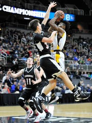Lakeshore's Max Gaishin defends a shot by Henry Ford's James Towns, right, in the first half.