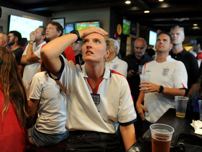 Paige Chisholm, a fan of England, watches to the World