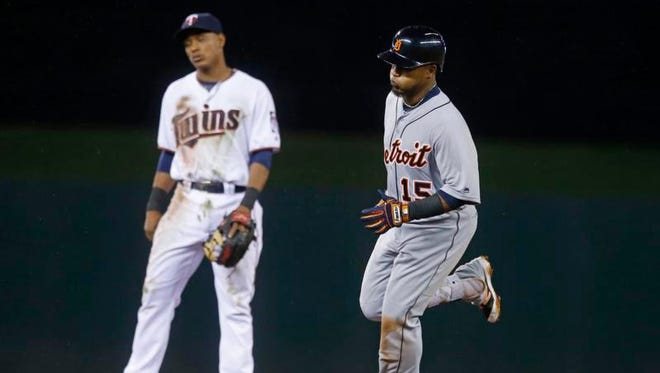 Detroit's Erick Aybar, right, jogs the bases past Twins shortstop Jorge Polanco after his solo home run off Michael Tonkin during the seventh inning in Minneapolis Tuesday.
