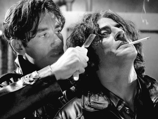 "Dwight (Clive Owen) has the edge — and the knife — over Jackie Boy (Benicio Del Toro) in ""Sin City"" (2005)."