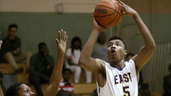 East's Theodore Buckner (5) turns and shoots over Wilson's Donovan Campbell.