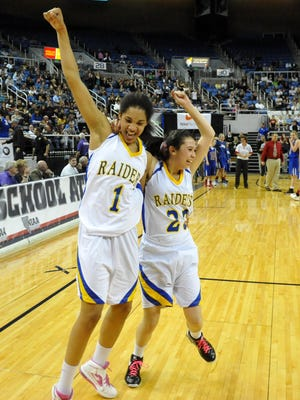 Reed's Gabby Williams, left, and Brooke Cervantes celebrate after beating Reno for the girls basketball state championship in 20.12