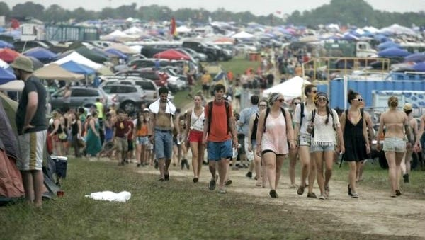 Festival goers walk the lanes at the campsite before the gates open at the Bonnaroo Music & Arts Festival on Thursday, June 13, 2013 in in Manchester, Tenn.