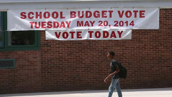A student walks out of the Alice Grady School in Elmsford while the annual school budget/school board vote is going on inside  May 20, 2014.