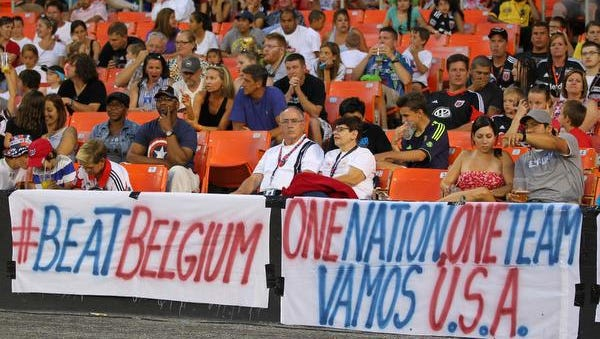 D.C. United fans display signs in support of the U.S. team in the World Cup during Saturday's Major League Soccer game in Washington.