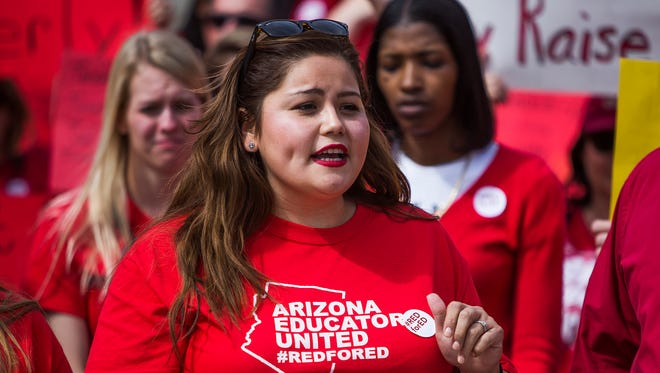 Teacher Kassandra Dominguez, organizer of the #RedForEd rally at the Arizona Capitol, speaks to several hundred teachers protesting low pay on  March 21, 2018.