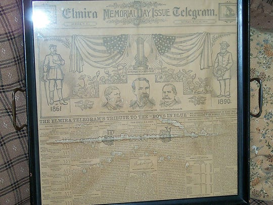 This tray contains a page from an 1890 issue of the