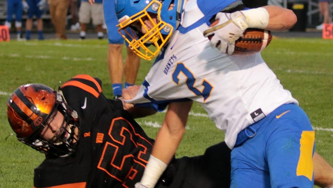 Seth Schwab of Ridgewood pulls Nathanael Suntheimer of East Canton to the ground in the first quarter of the game the Generals hosted against the Hornets.