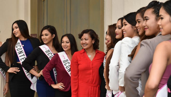 The 2016 Miss Universe Guam contestants pose for pictures at the Hyatt Regency Guam on Monday, Aug. 1.
