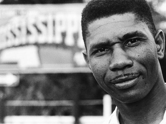 Medgar Evers, the NAACP's first field secretary for Mississippi, stands near a Mississippi state sign in this 1958 photo. He was assassinated in the driveway of his Jackson home in 1963, and his death helped to inspire changes in both Mississippi and the nation.