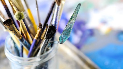 A stock image of dirty paintbrushes.