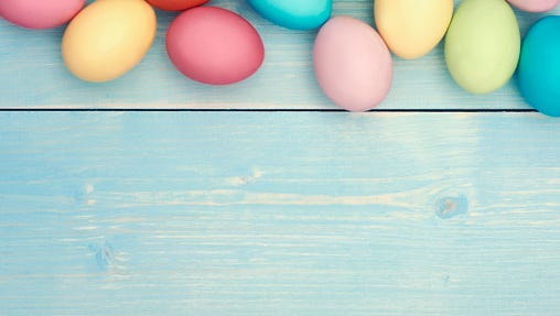 Colorful easter eggs on wooden plank
