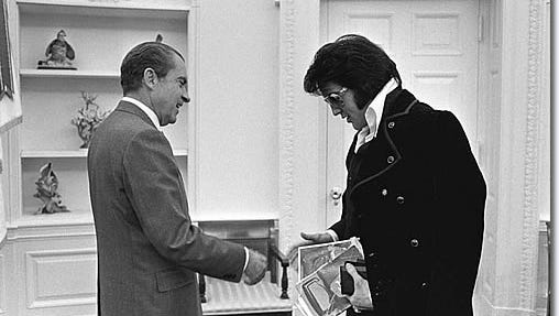 "The moment when former President Richard Nixon met Elvis Presley is recalled in ""The King."""