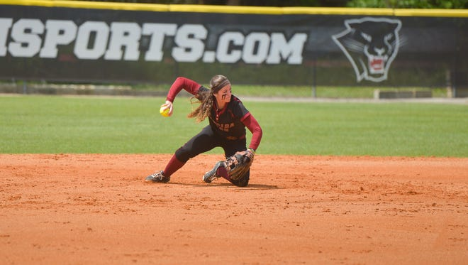 Florida Tech second baseman Elizabeth Eby makes a throw from her knee after making a stop.
