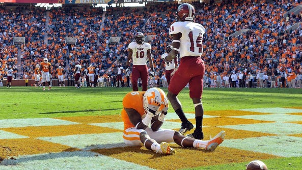 Tennessee wide receiver Vincent Dallas (6) reacts after
