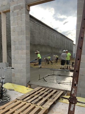 """The Bastrop Economic Development Corp. held a """"pour day"""" last Friday as contractors poured the concrete slab of the future Art Institute building located at 921 Main Street in downtown Bastrop."""