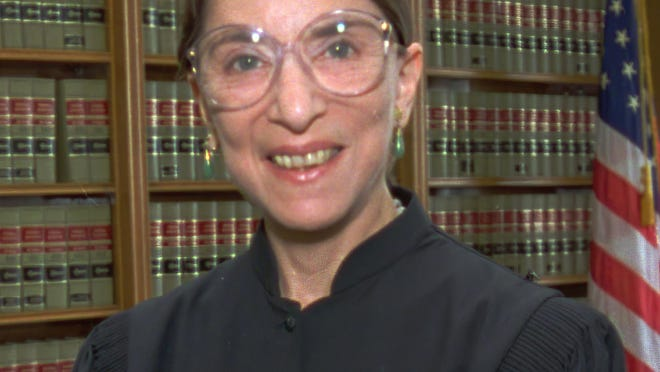 Judge Ruth Bader Ginsburg poses in her office at U.S. District Court in Washington Tues., April 3, 1993.