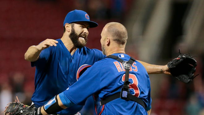Jake Arrieta celebrates with catcher David Ross  after throwing a no-hitter Thursday night against the Reds.
