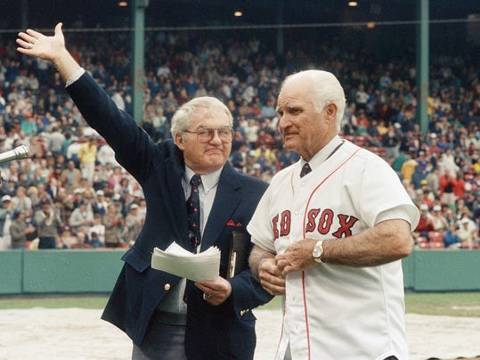 """FILE - In this May 21, 1988, file photo, the radio voice of the Boston Red Sox, Kent Coleman, left, presents former Red Sox second baseman Bobby Doerr to the crowd at Fenway Park during a ceremony to retire his number 1. Doerr, a Hall of Fame second baseman who was dubbed the """"silent captain"""" by longtime Red Sox teammate and life-long friend Ted Williams, has died. He was 99. (AP Photo/Carol Francavilla, File)"""